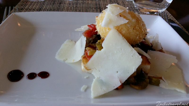 Warm Ratatouille on top of brioche bread with poached and fried egg, and La Suerte cheddar cheese shavings